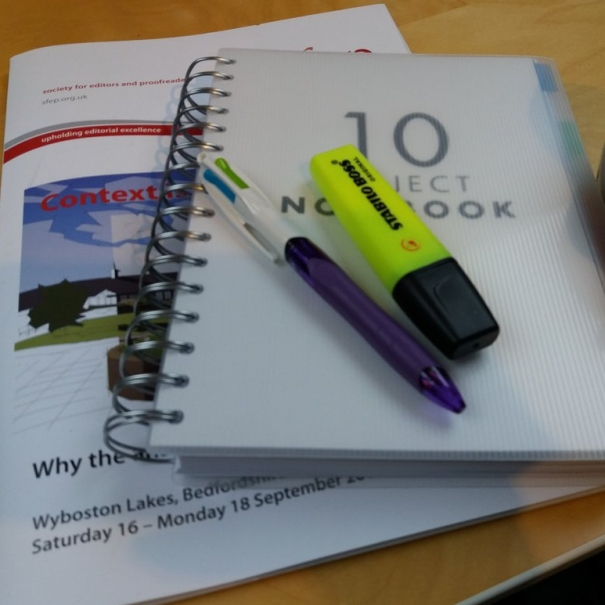 Notepad, pens and conference programme