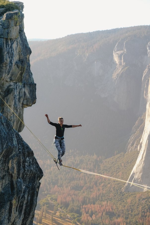 A picture of a person walking a tightrope